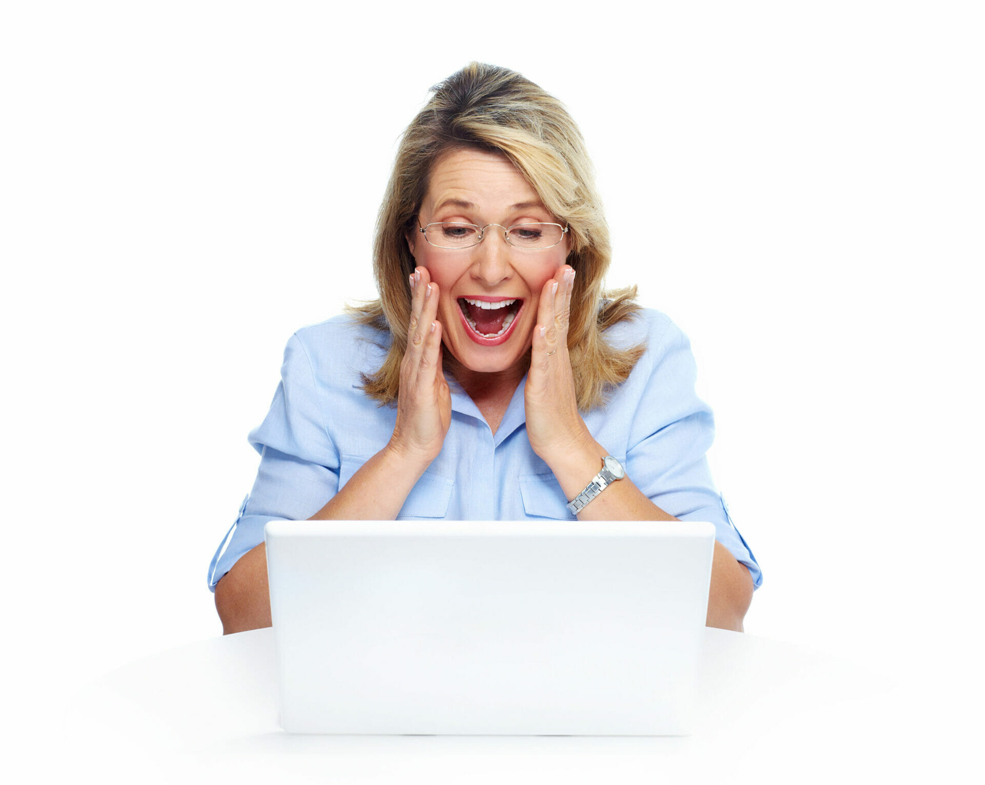 Happy senior woman with laptop computer. Isolated over white bac